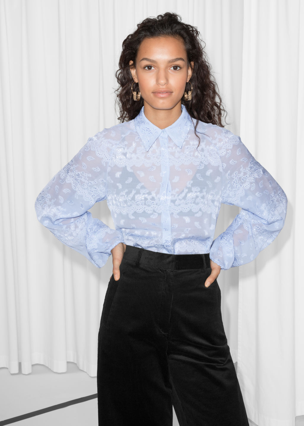 Model front image of Stories billowy jacquard blouse in blue