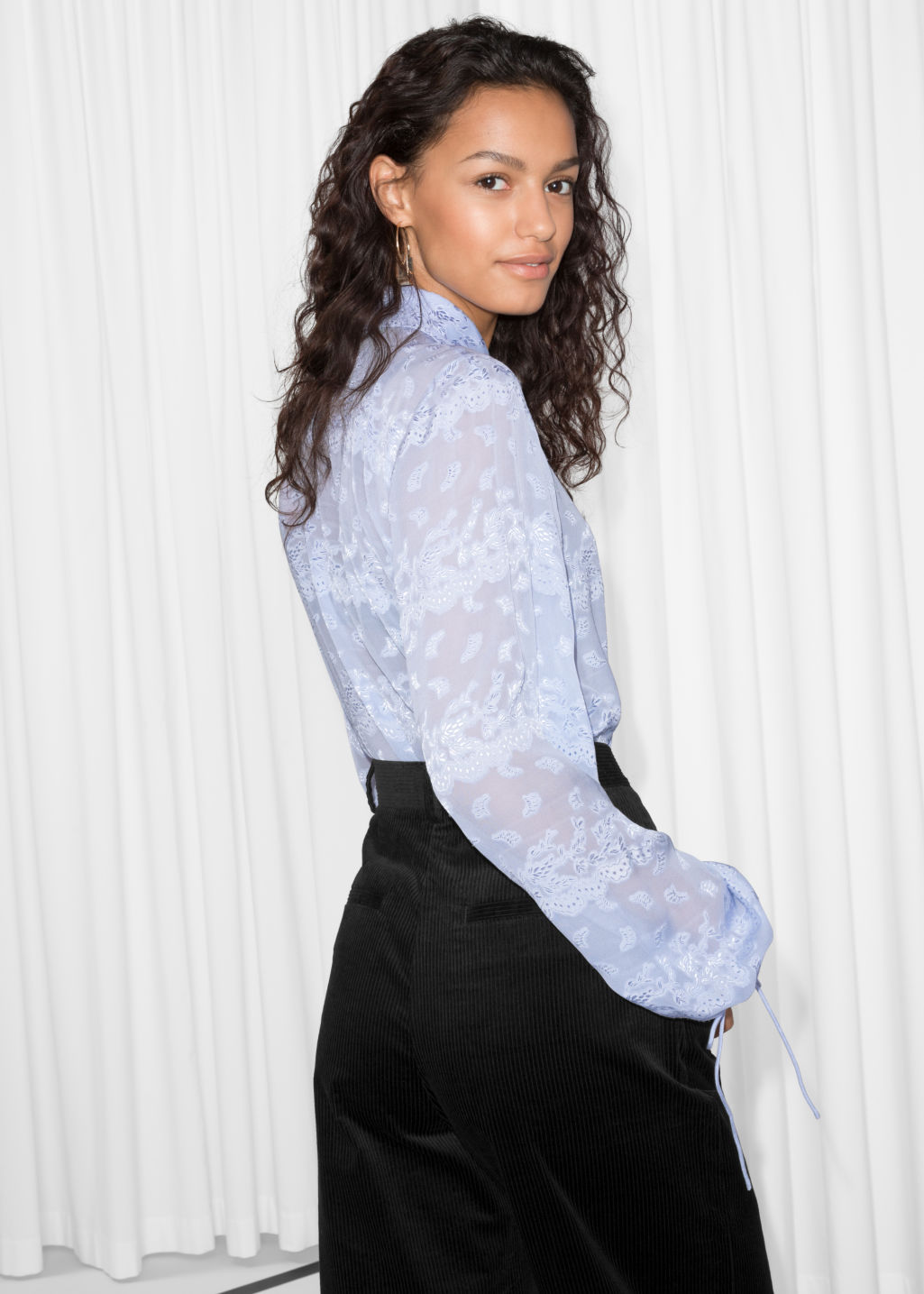 Model back image of Stories billowy jacquard blouse in blue