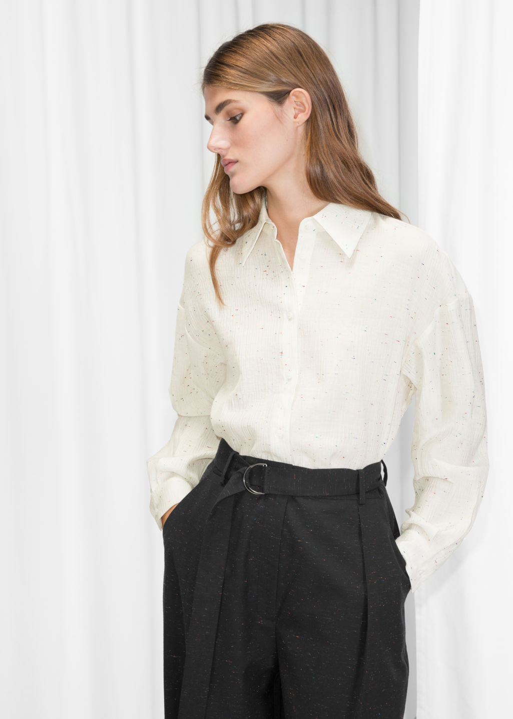 Model front image of Stories button up blouse in white