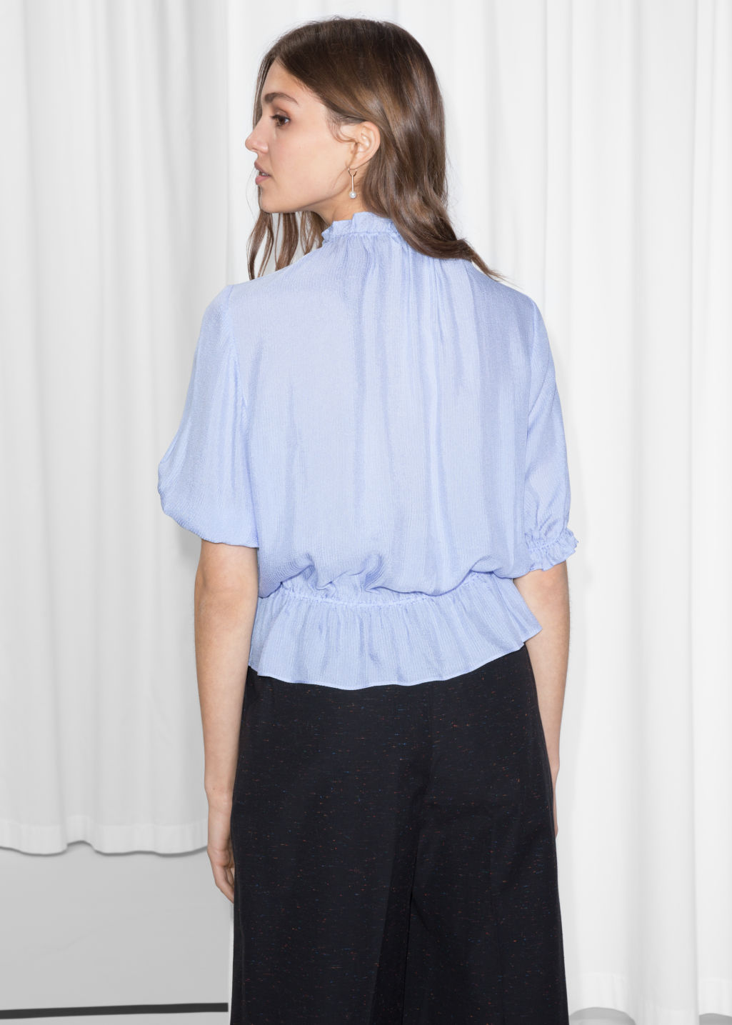 Model front image of Stories gathered high neck blouse in blue