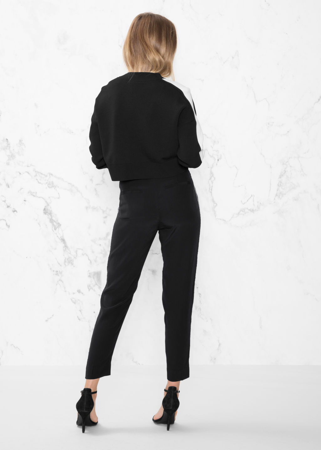 Model back image of Stories rhinestone trim trousers in black