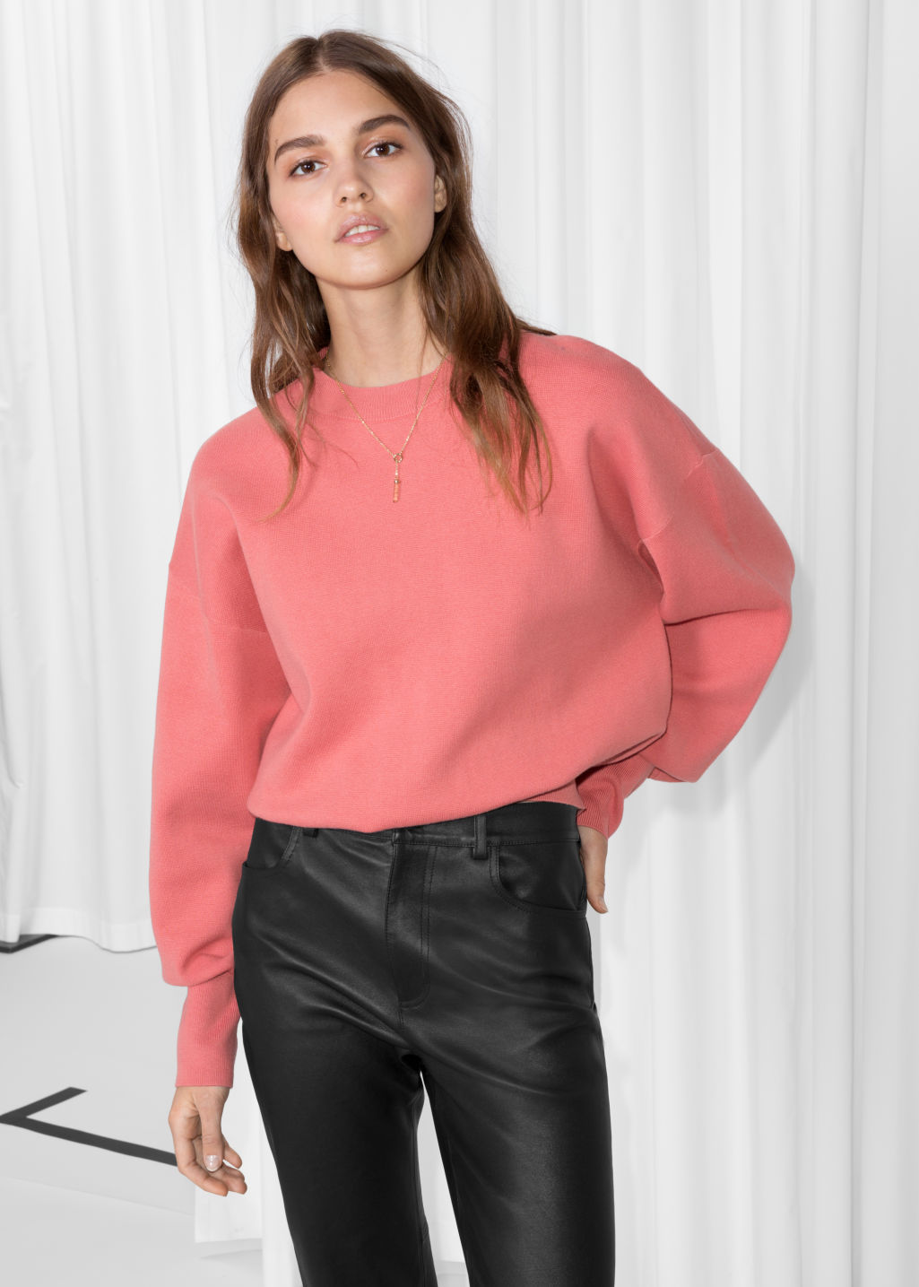 Model front image of Stories cropped knit sweater in pink