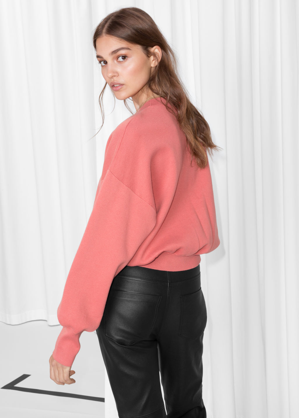 Model back image of Stories cropped knit sweater in pink