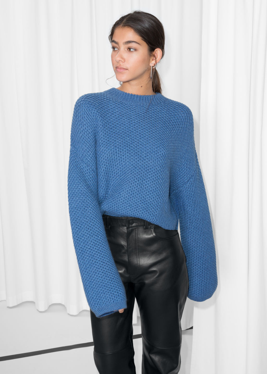 Model front image of Stories cropped honeycomb knit sweater  in blue