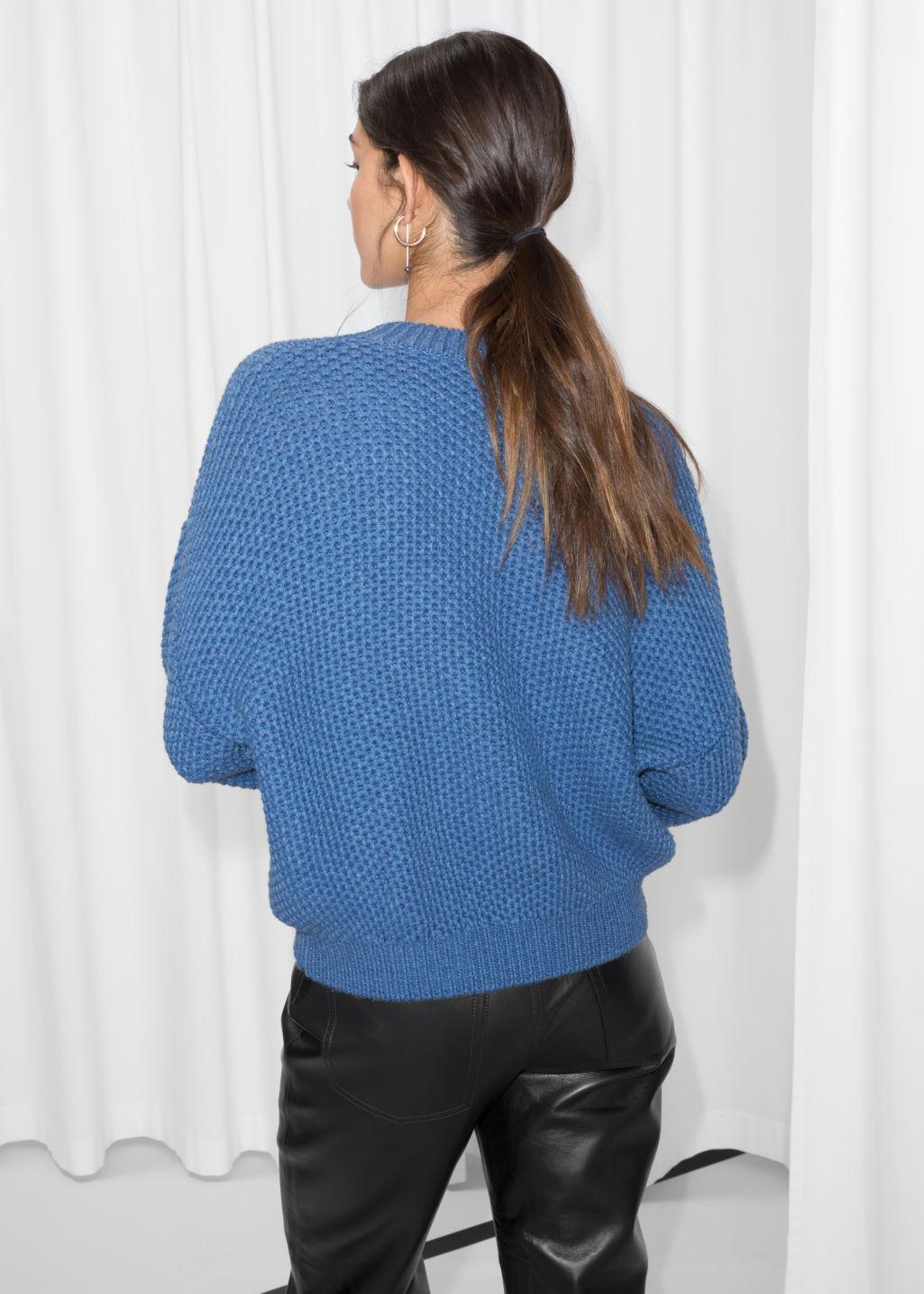 Model back image of Stories cropped honeycomb knit sweater  in blue