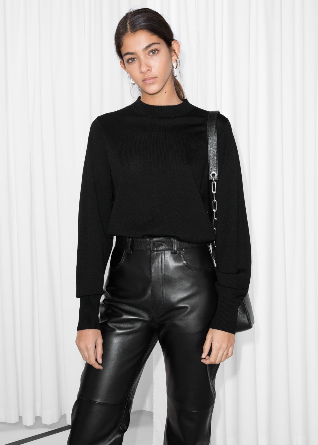 Model front image of Stories straight mock neck sweater in black