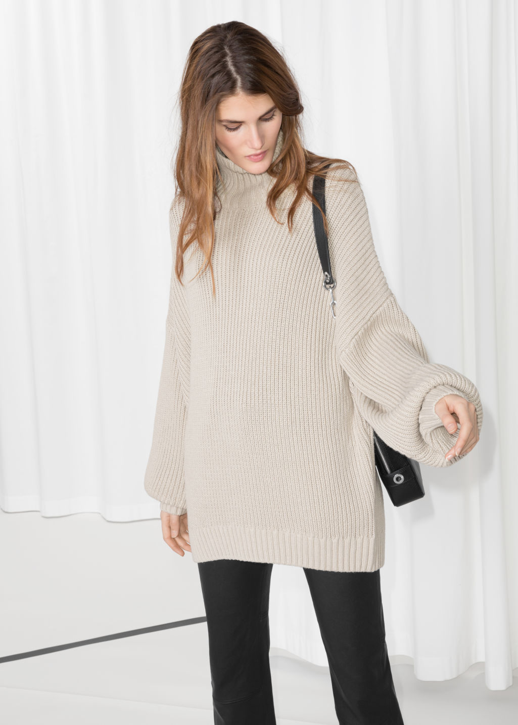 Model front image of Stories jumbo turtleneck sweater in beige
