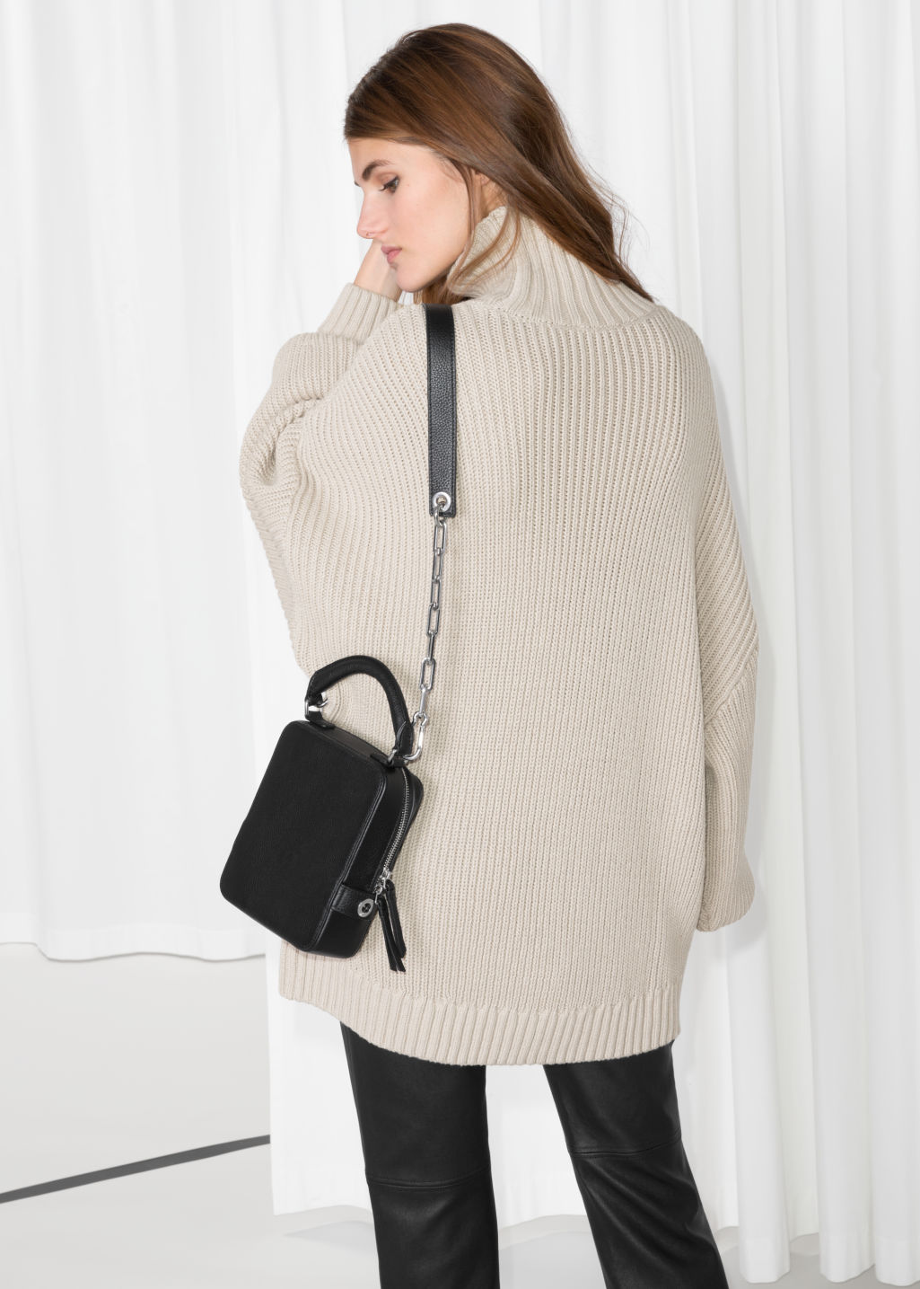 Model back image of Stories jumbo turtleneck sweater in beige
