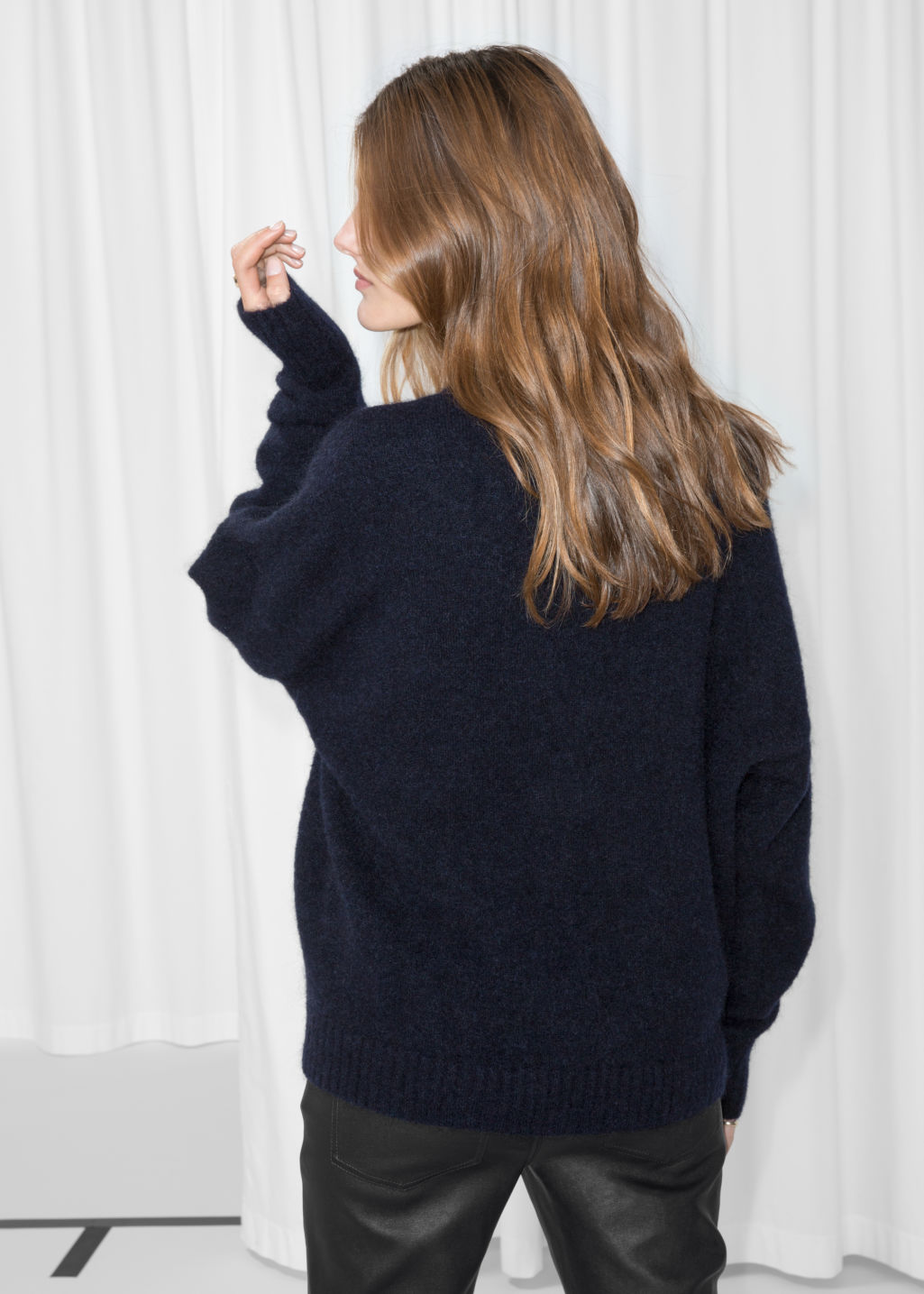 Model back image of Stories wool blend sweater in blue