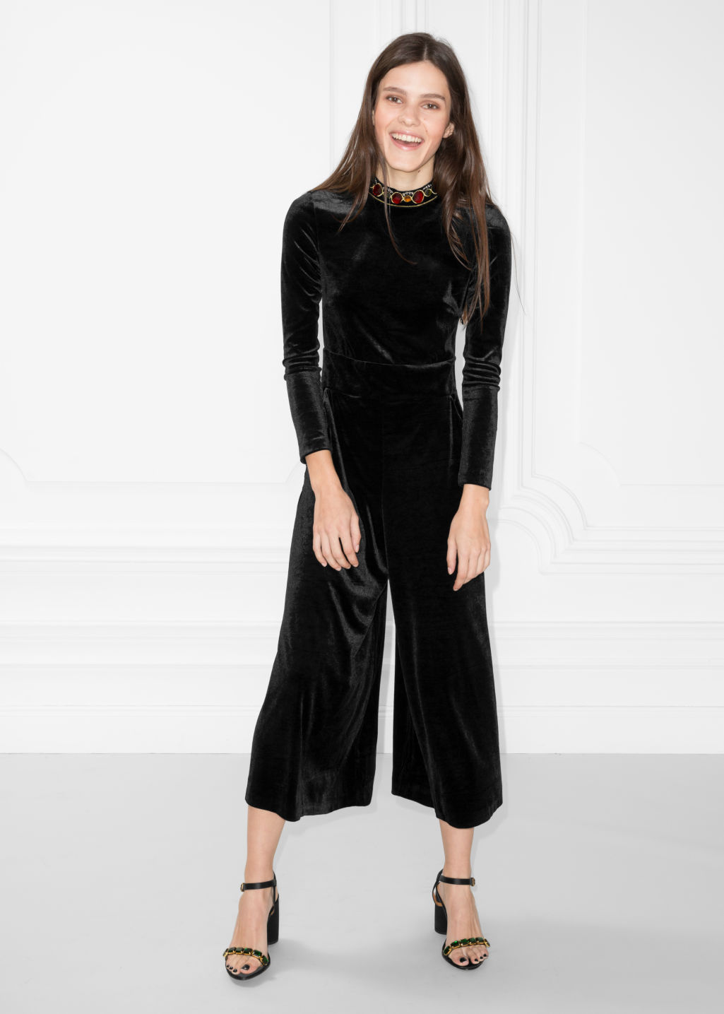 Model front image of Stories velvet jumpsuit in black