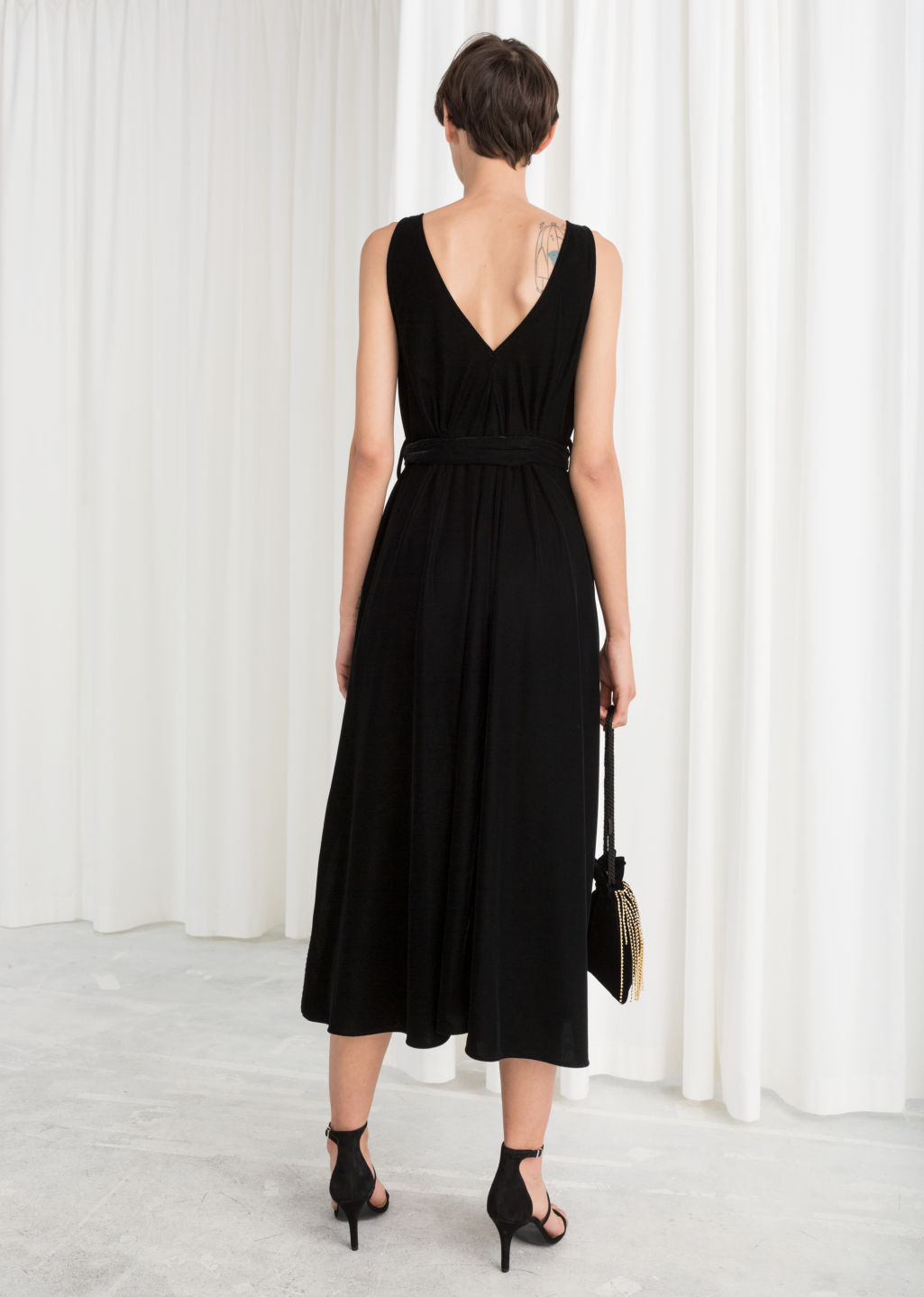 Model back image of Stories belted velvet midi dress in black