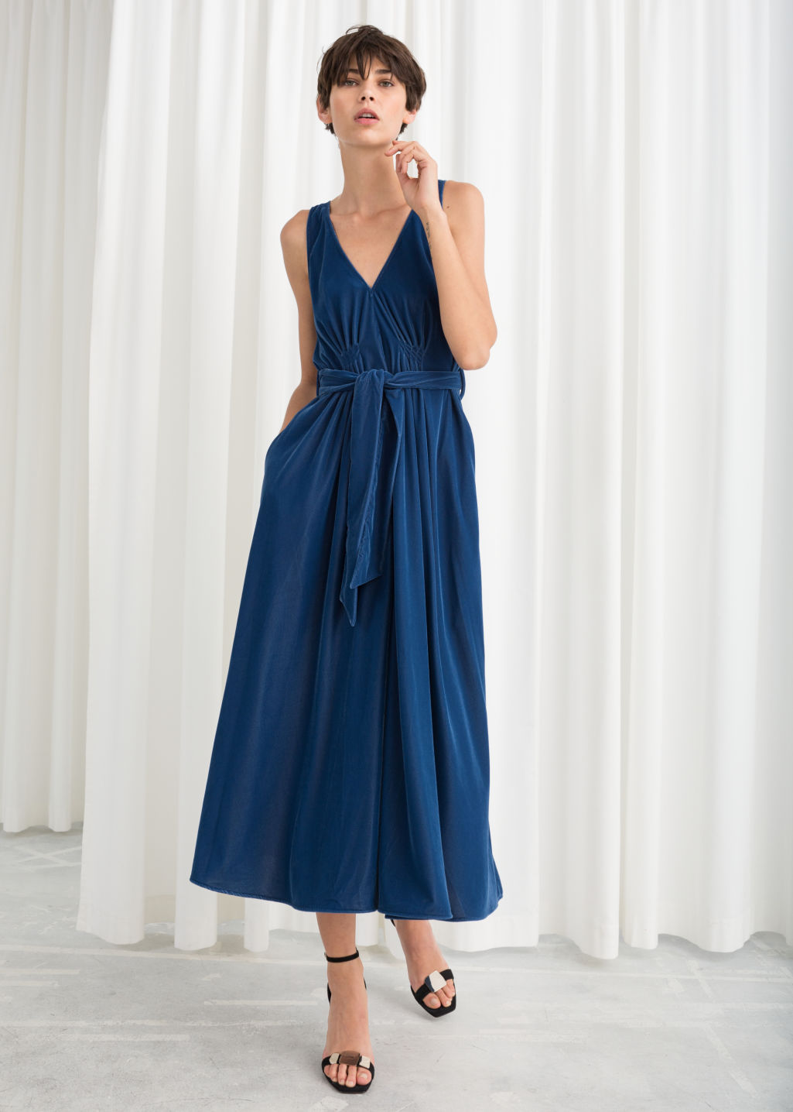 ca3e759bb84f Model front image of Stories belted velvet midi dress in blue ...