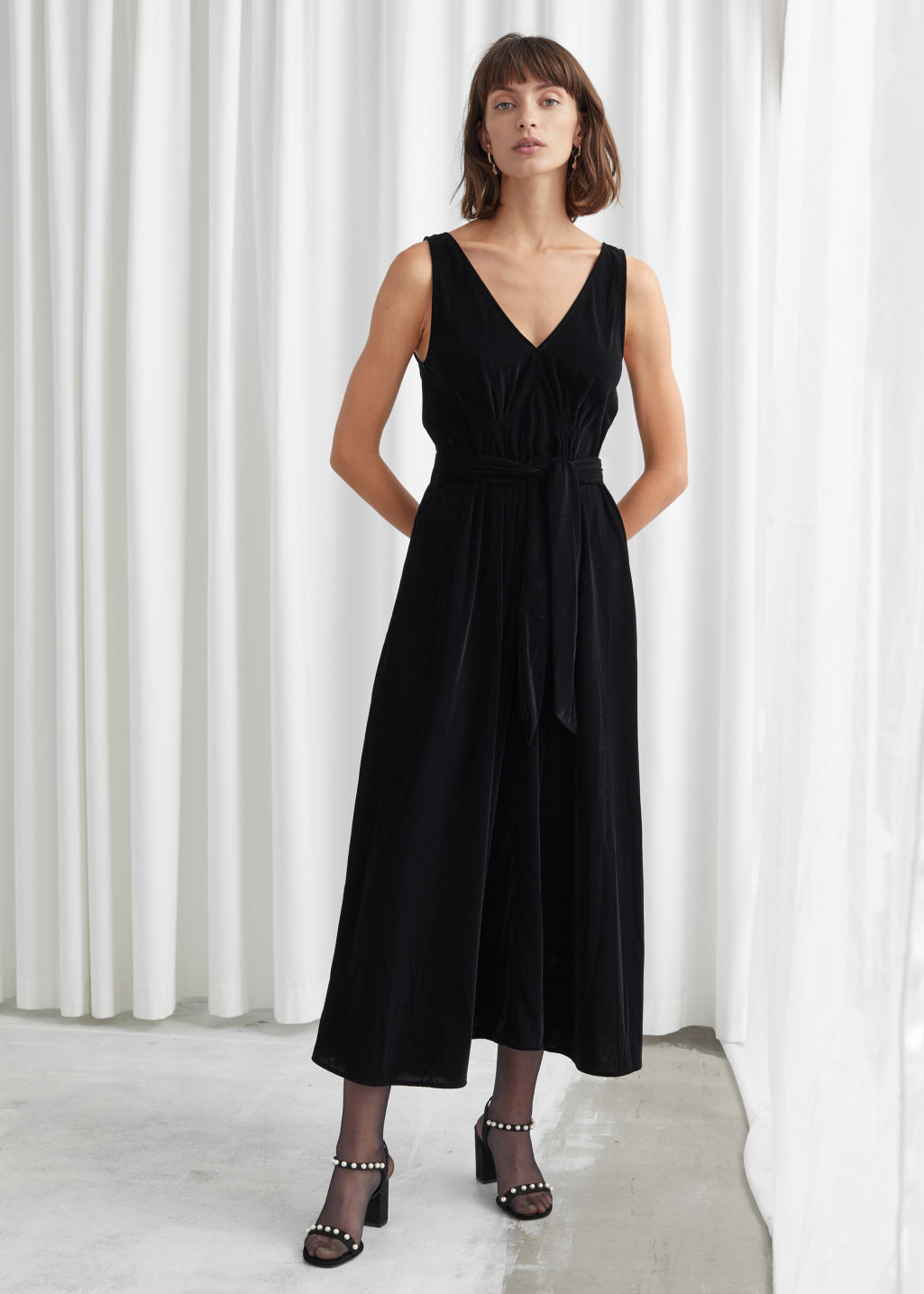 Model front image of Stories belted velvet midi dress in black
