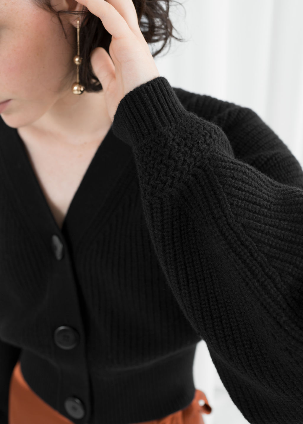 Model front image of Stories wool button sweater in black