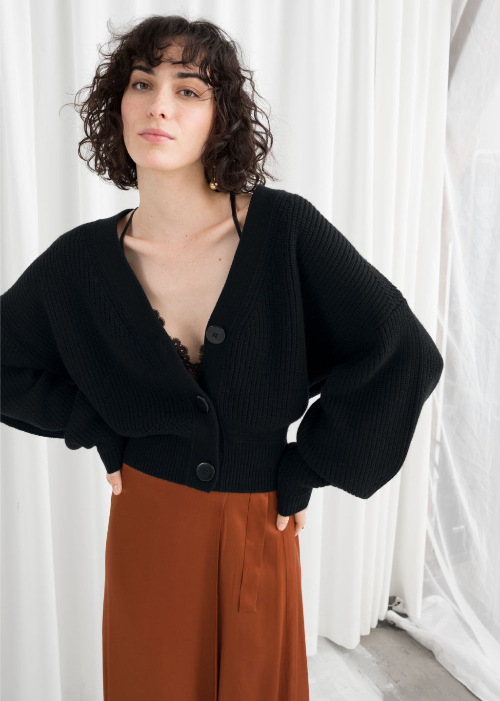 Model back image of Stories wool button sweater in black