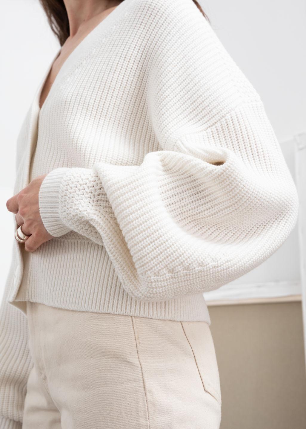 Model back image of Stories wool button sweater in white
