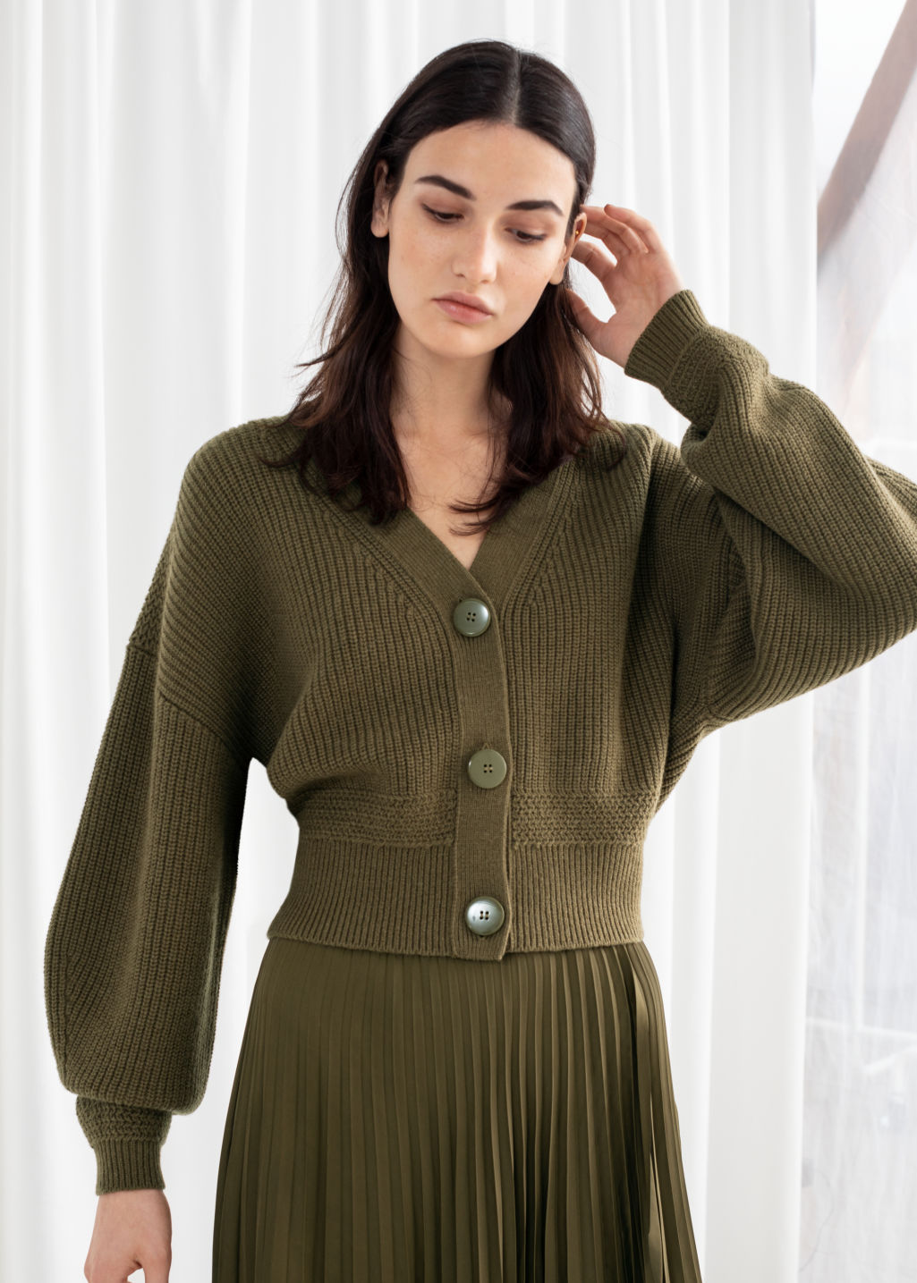 Model front image of Stories cropped cardigan in green