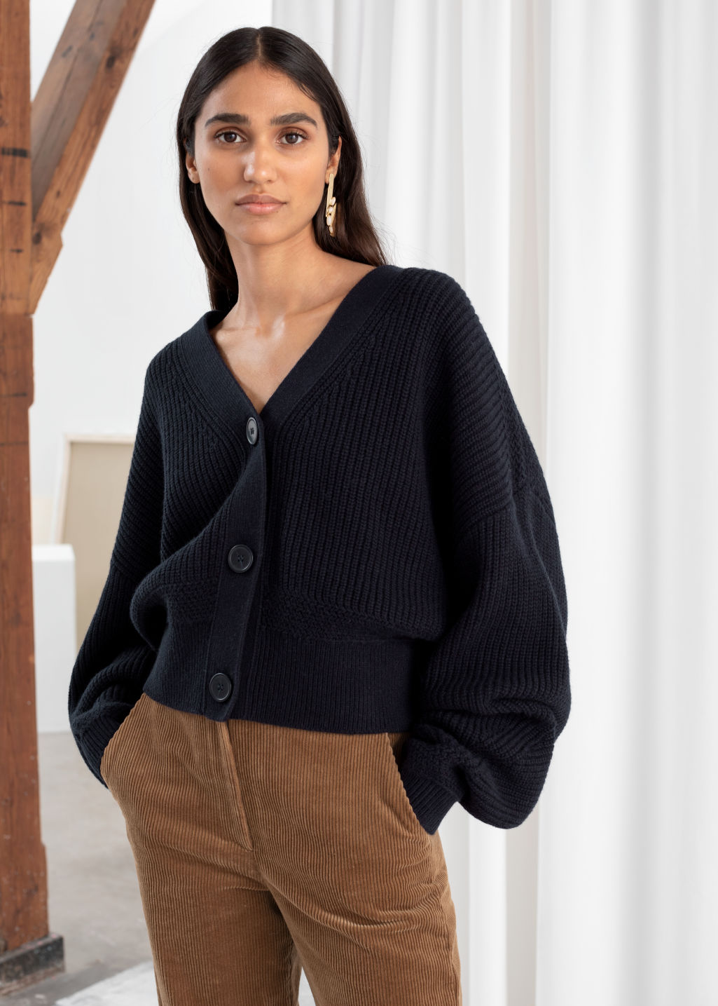 Model front image of Stories cropped cardigan in blue