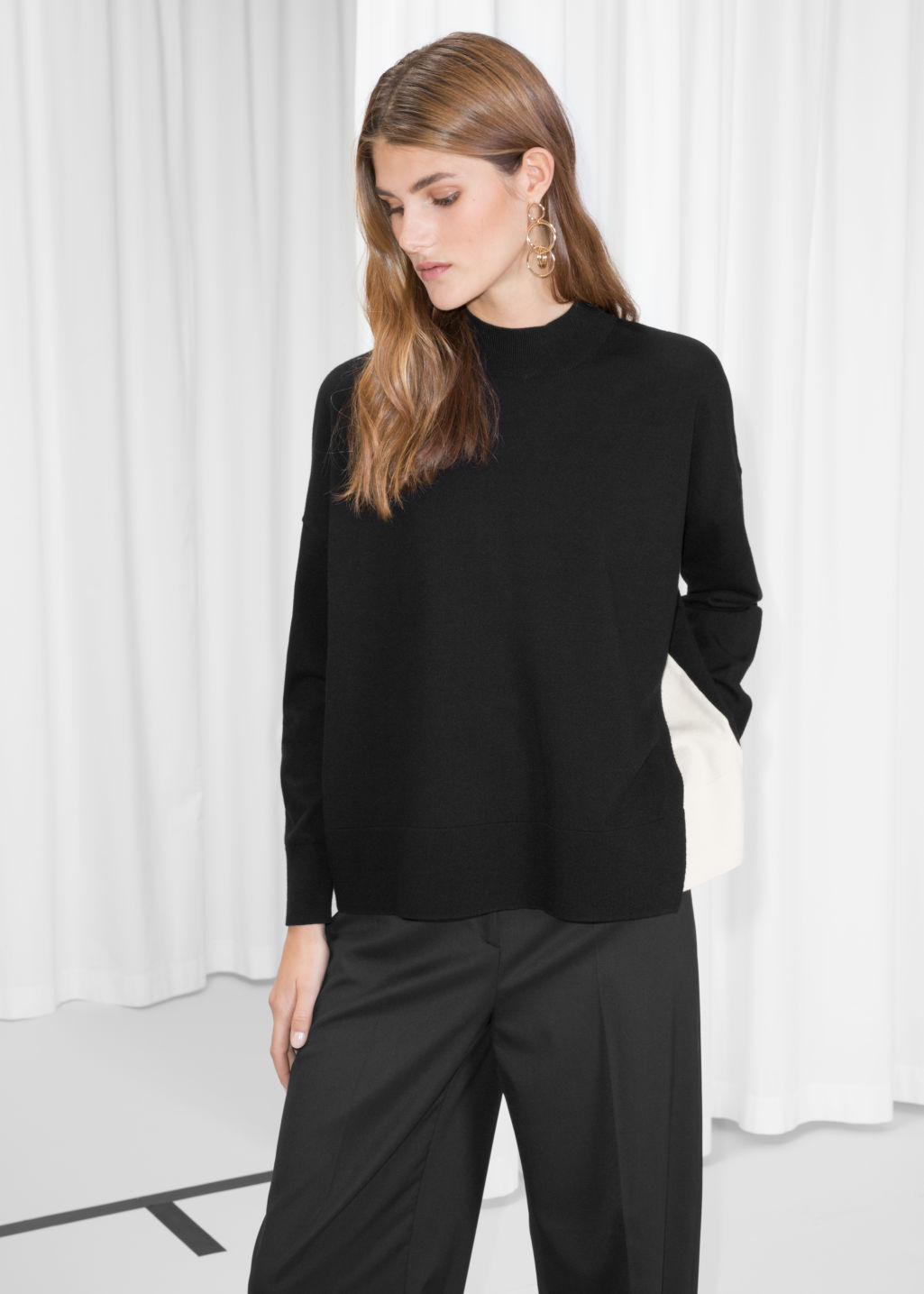 Model front image of Stories overlap color block sweater in black