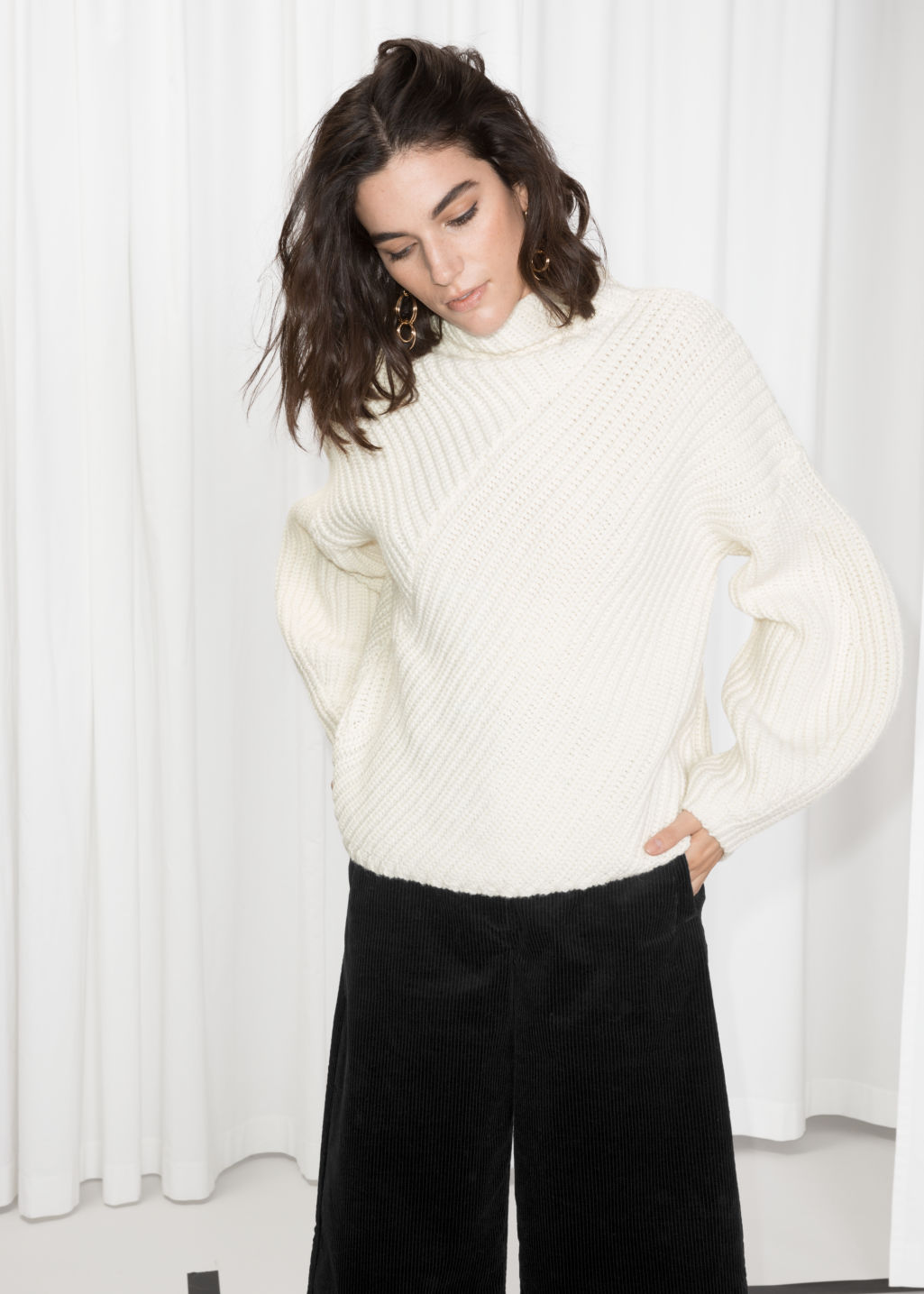 Model front image of Stories criss cross sweater in white