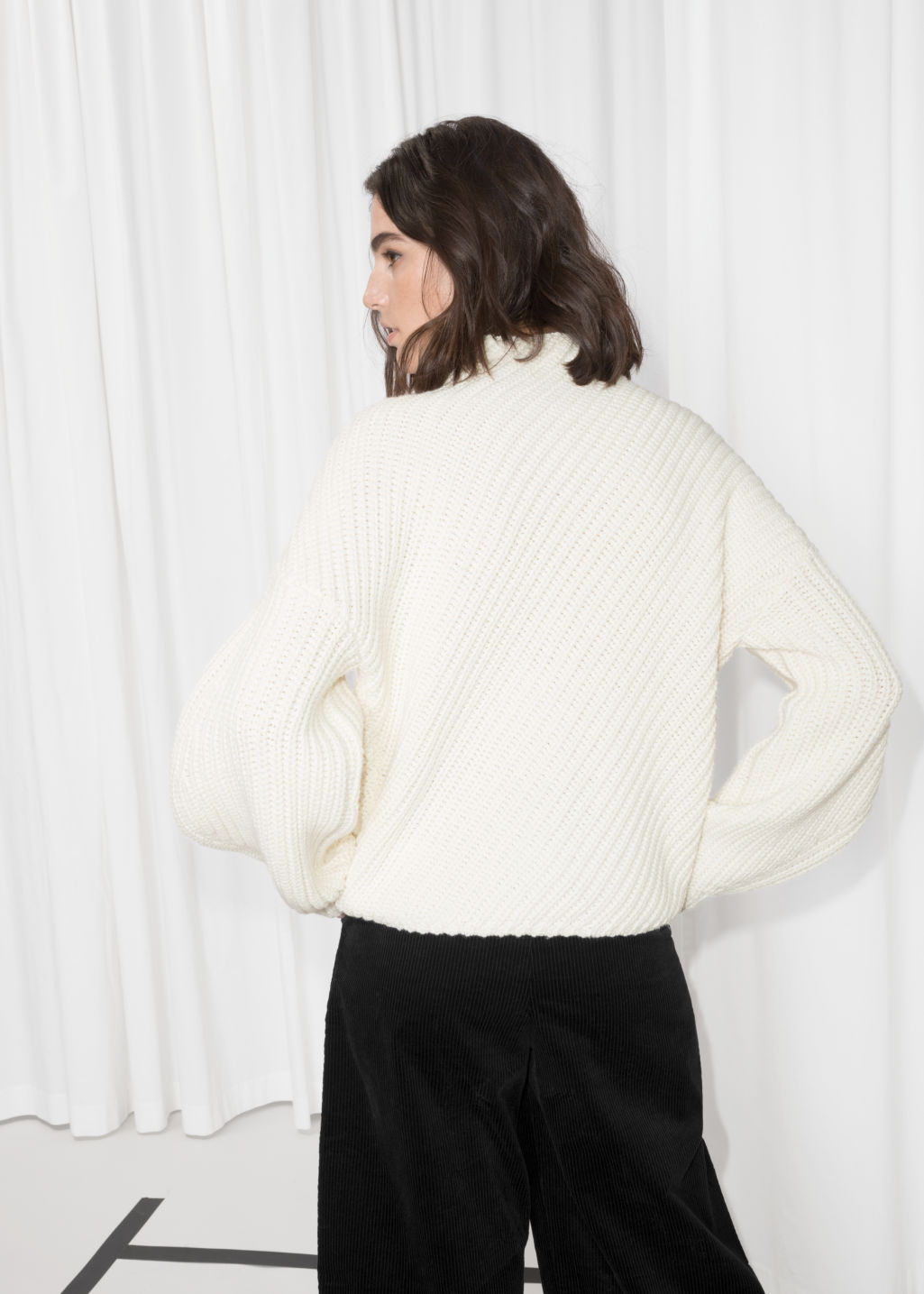 Model back image of Stories criss cross sweater in white