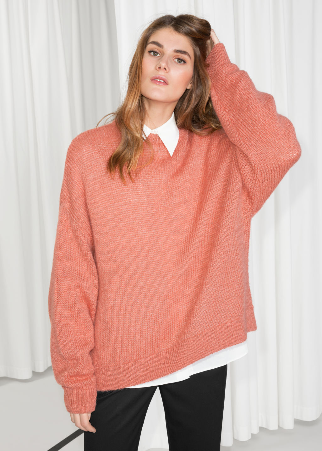 Model front image of Stories oversized sweater in orange