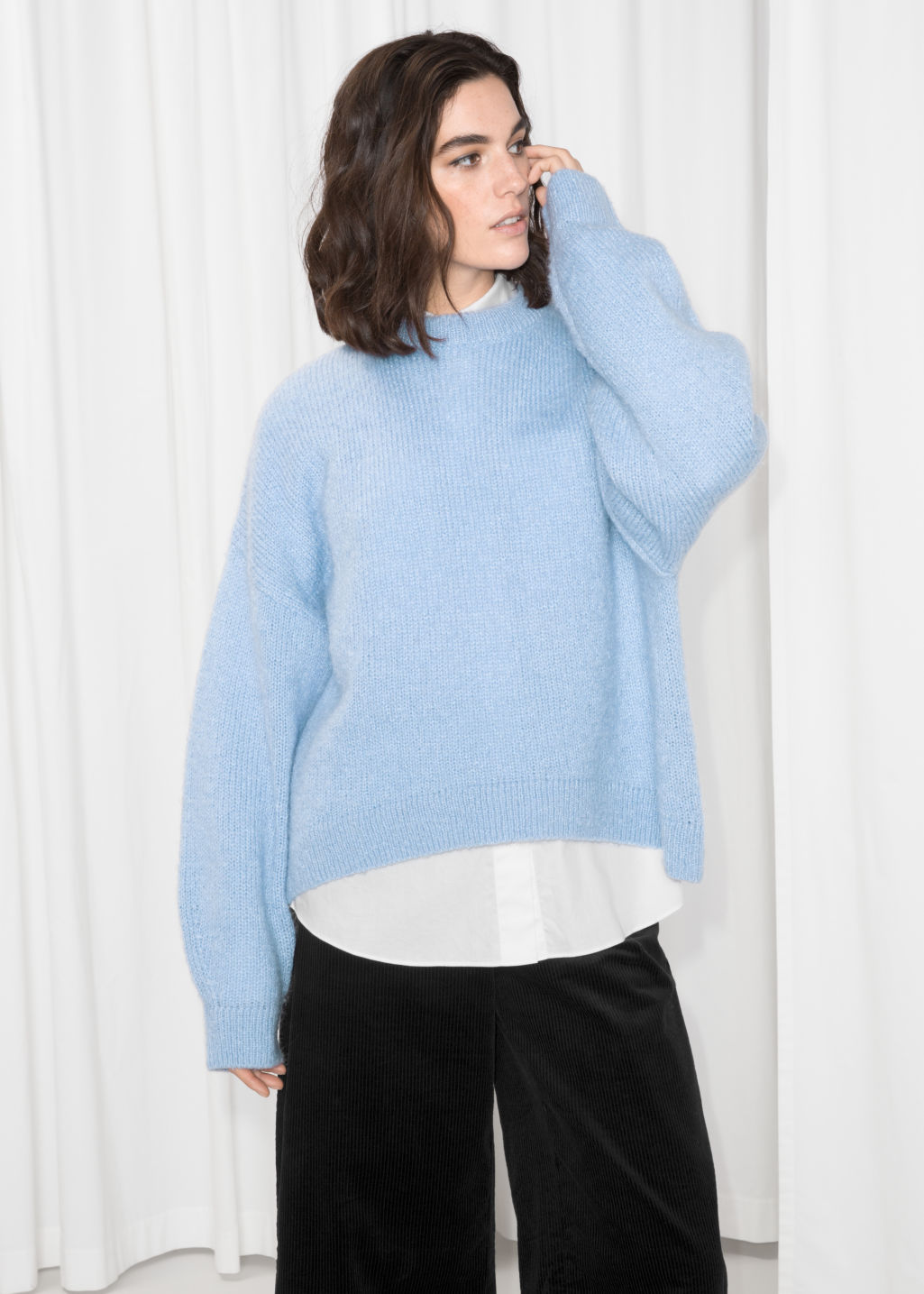 Model front image of Stories oversized sweater in blue