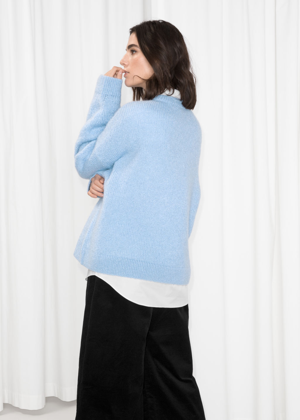 Model back image of Stories oversized sweater in blue