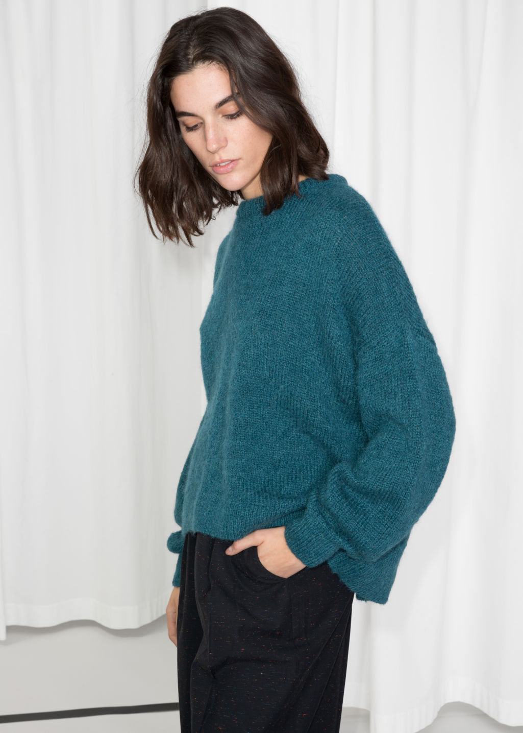 Model front image of Stories oversized sweater in turquoise
