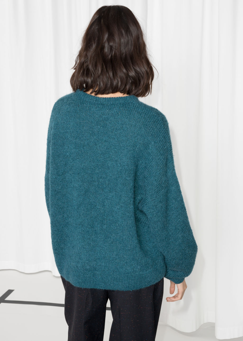 Model back image of Stories oversized sweater in turquoise