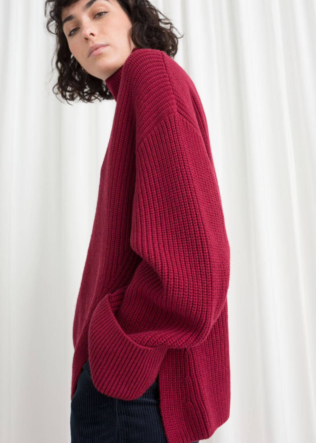 Model front image of Stories oversized side-slit turtleneck in red