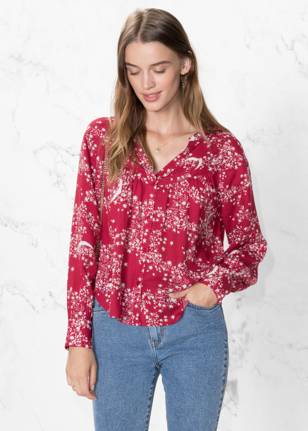 Model front image of Stories crescent blouse in pink