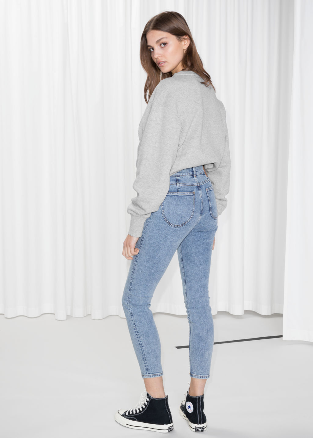 Model back image of Stories skinny fit jeans in blue