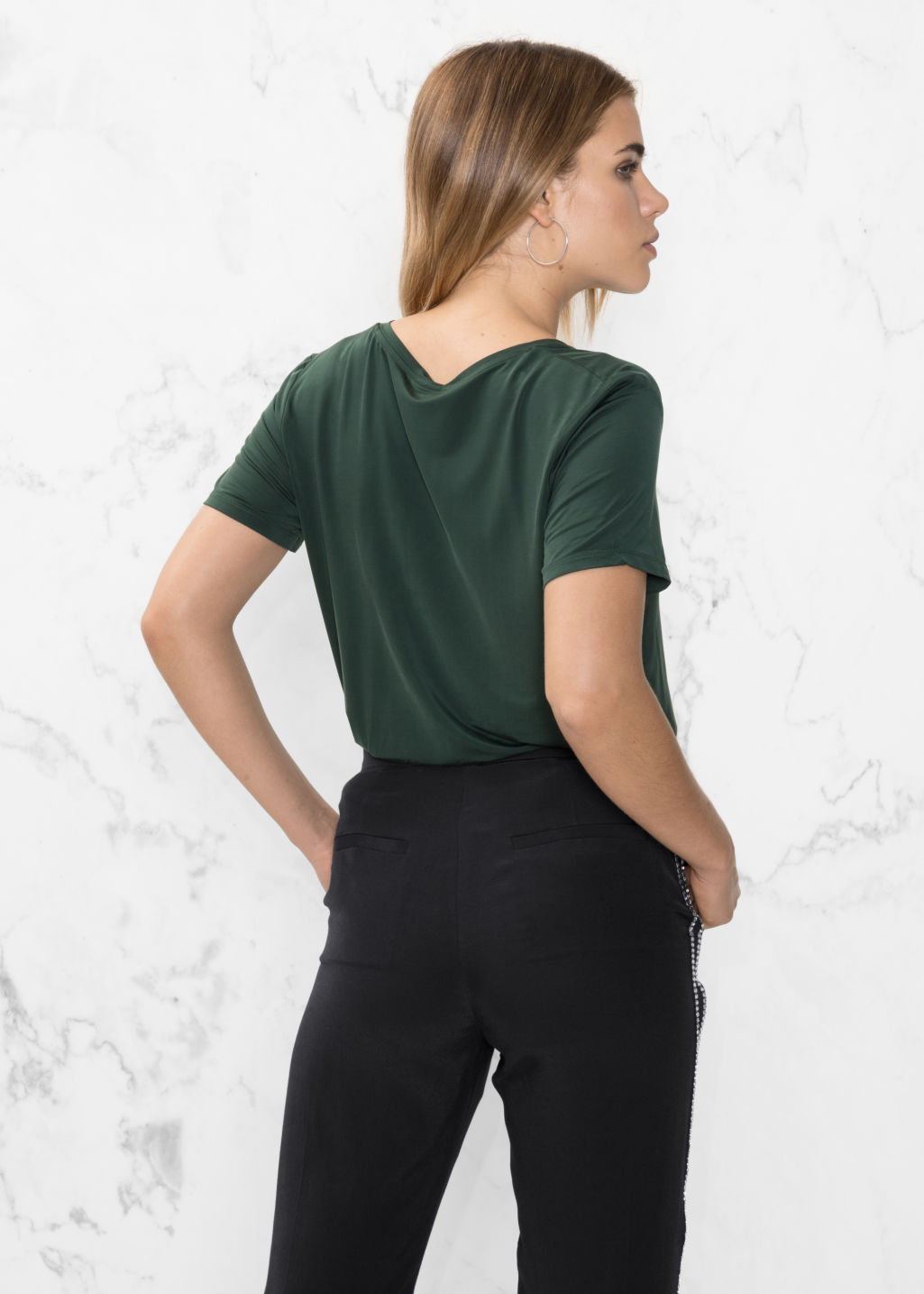 Model back image of Stories v-neck cupro top in green