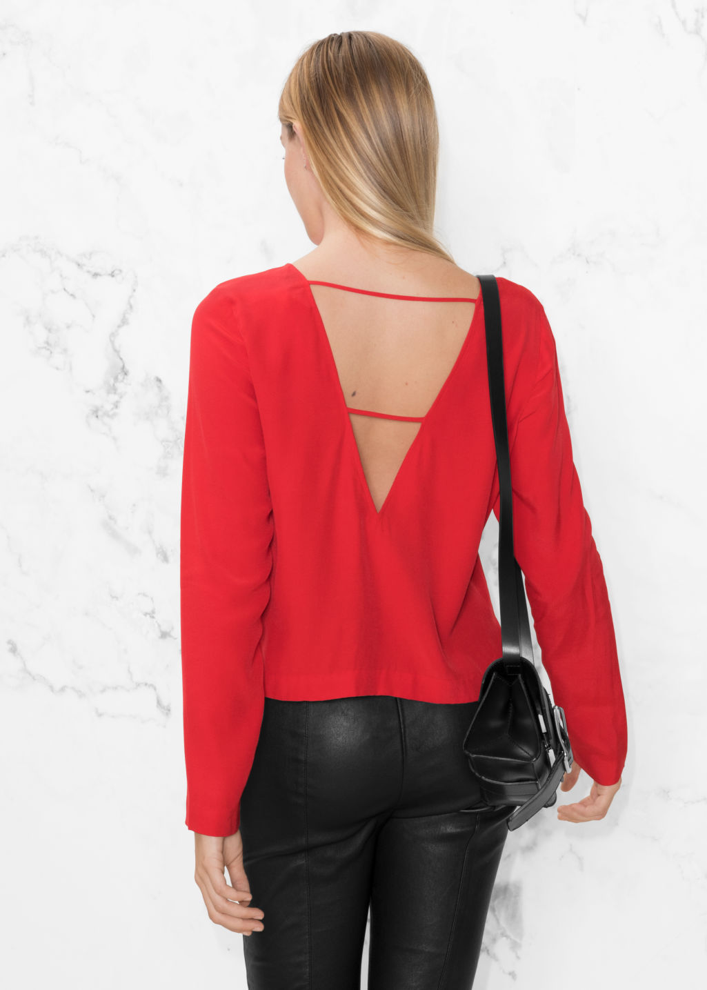 Model back image of Stories v-cut back sweater in red