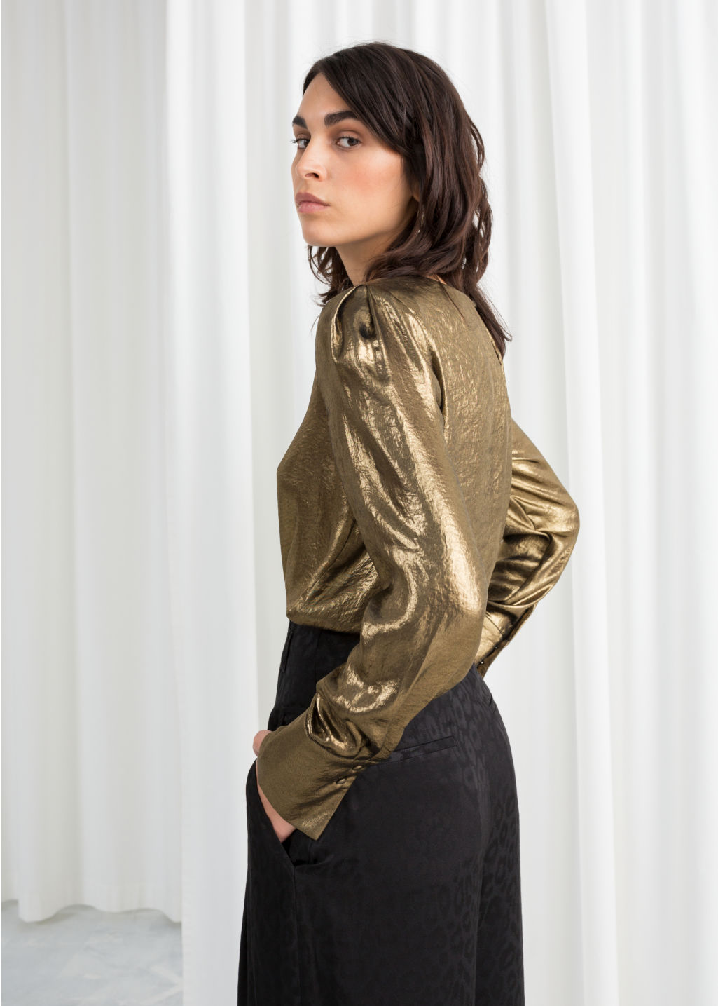 Model back image of Stories metallic satin blouse  in gold