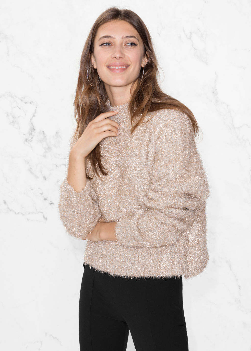 Model front image of Stories fuzzy sweater in gold