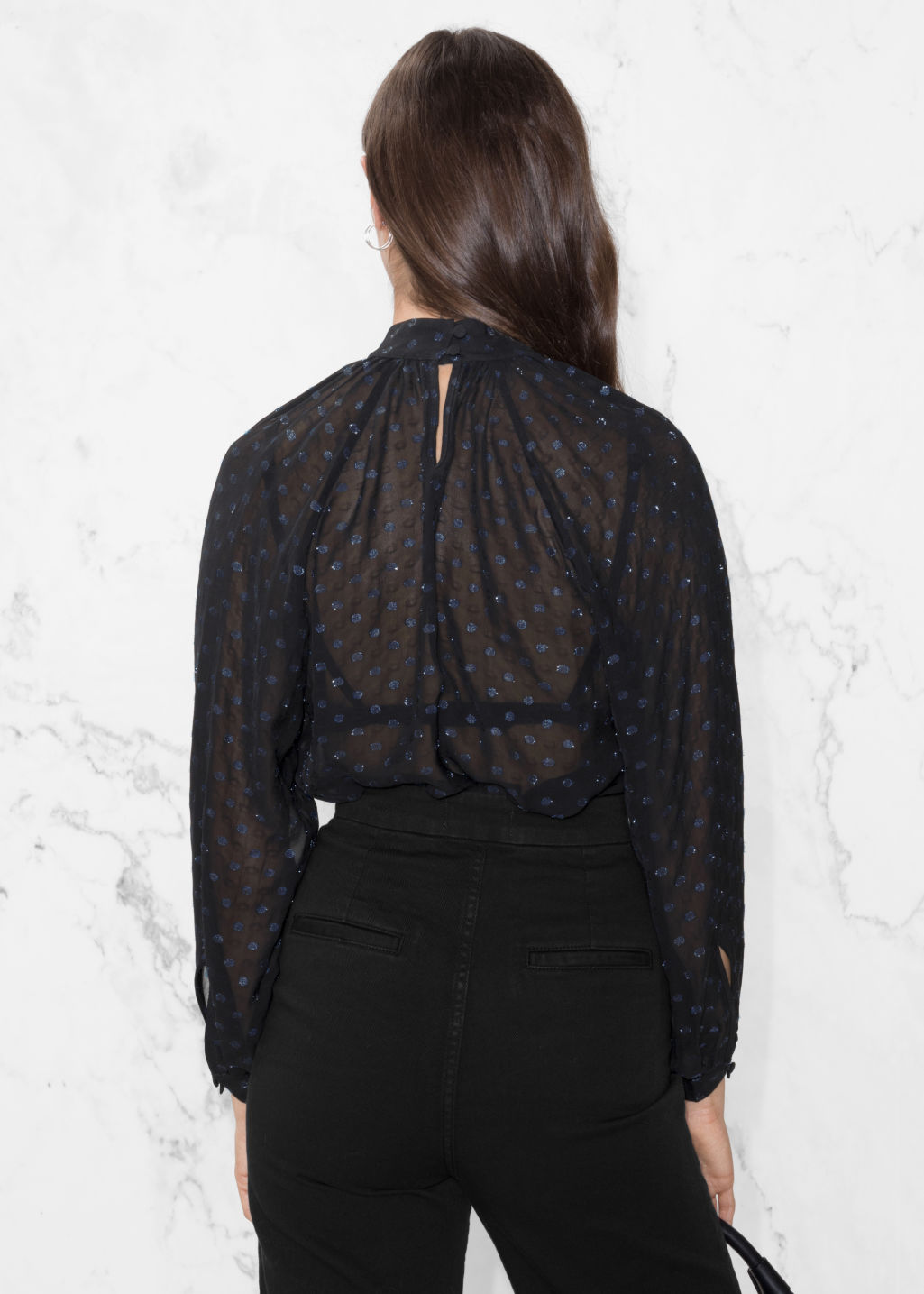 Model back image of Stories sheer sequin blouse in black