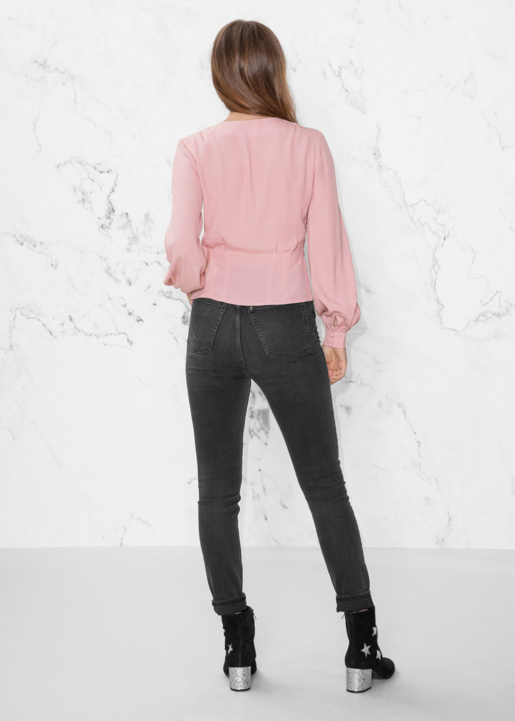 Model back image of Stories ruffled v-neck blouse in pink