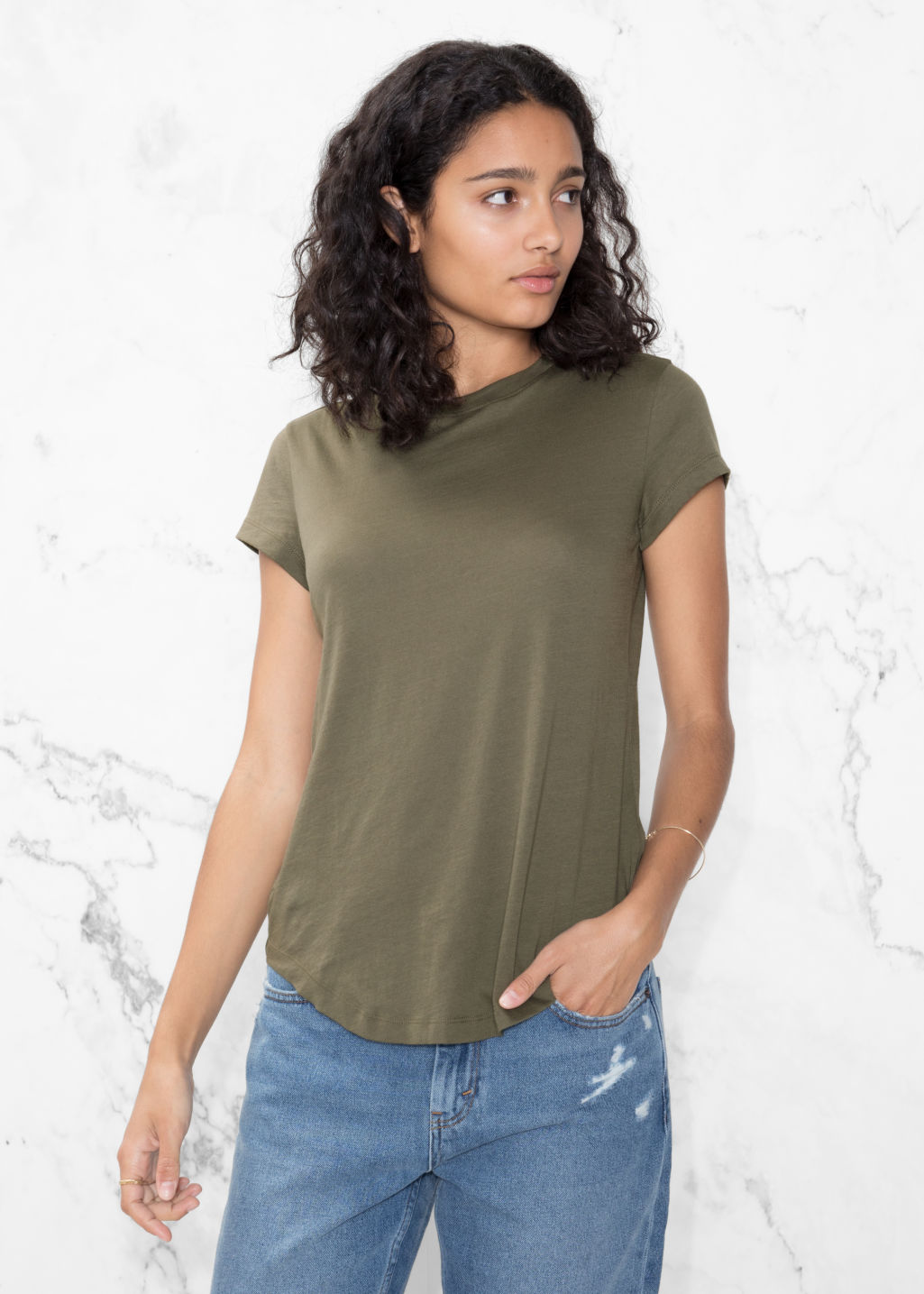 Model front image of Stories organic cotton t-shirt in green