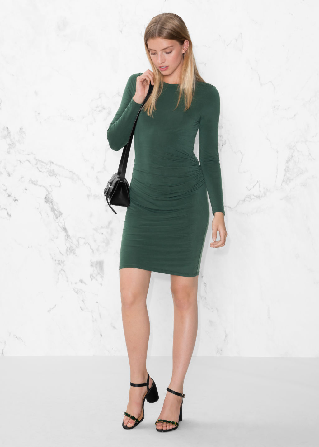 Model front image of Stories draped mini dress in green