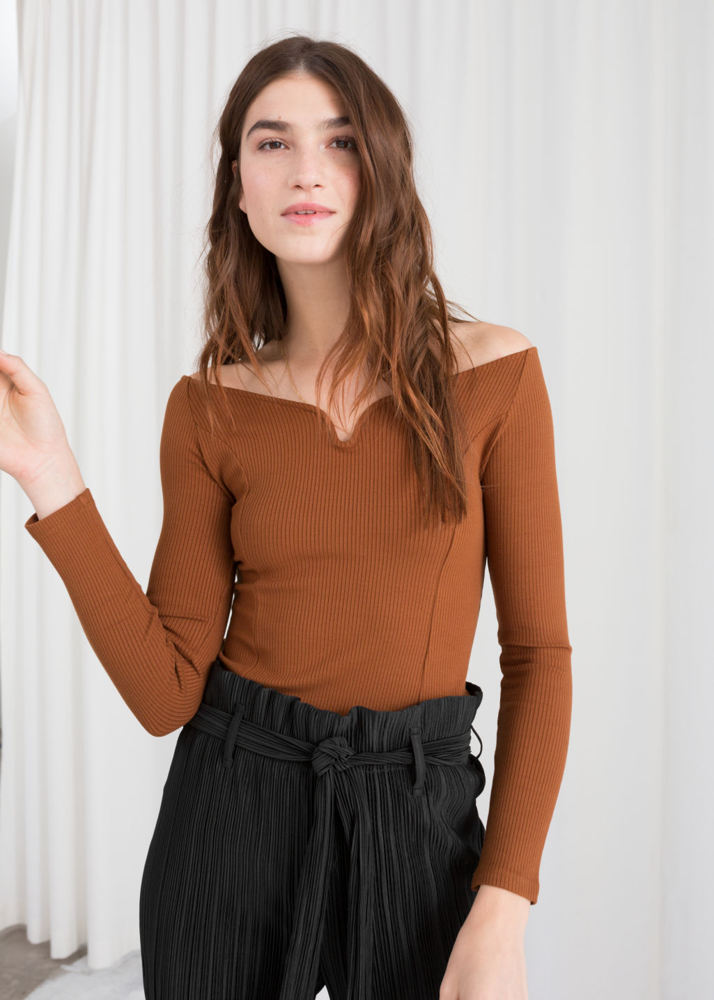 Model front image of Stories fitted dip neck top in brown