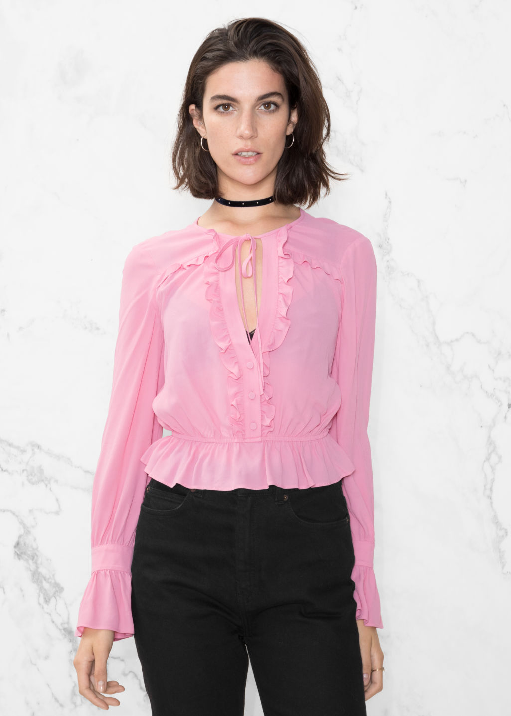 Model front image of Stories ruffled blouse in pink