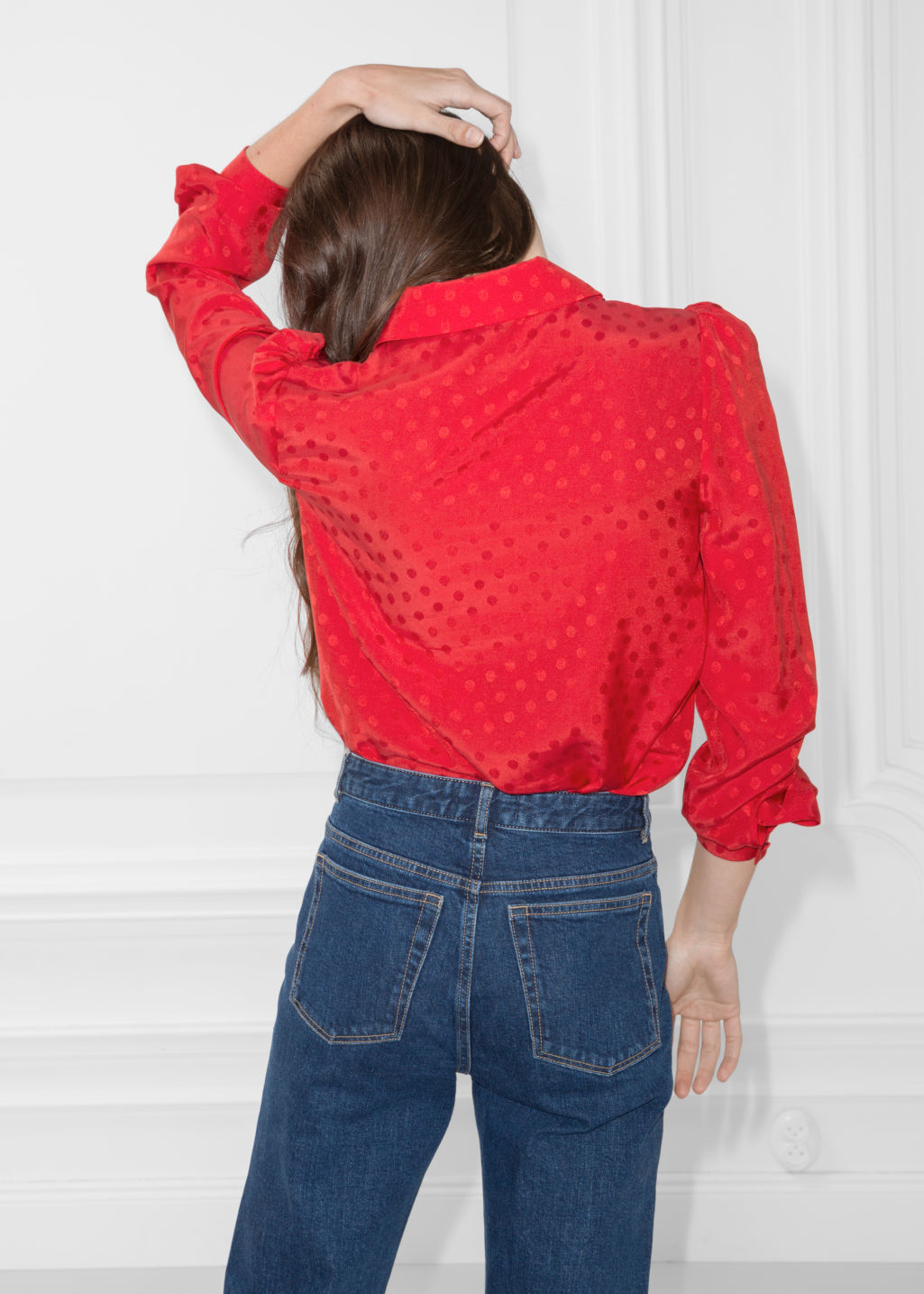 Model back image of Stories ascot ruffle blouse in red