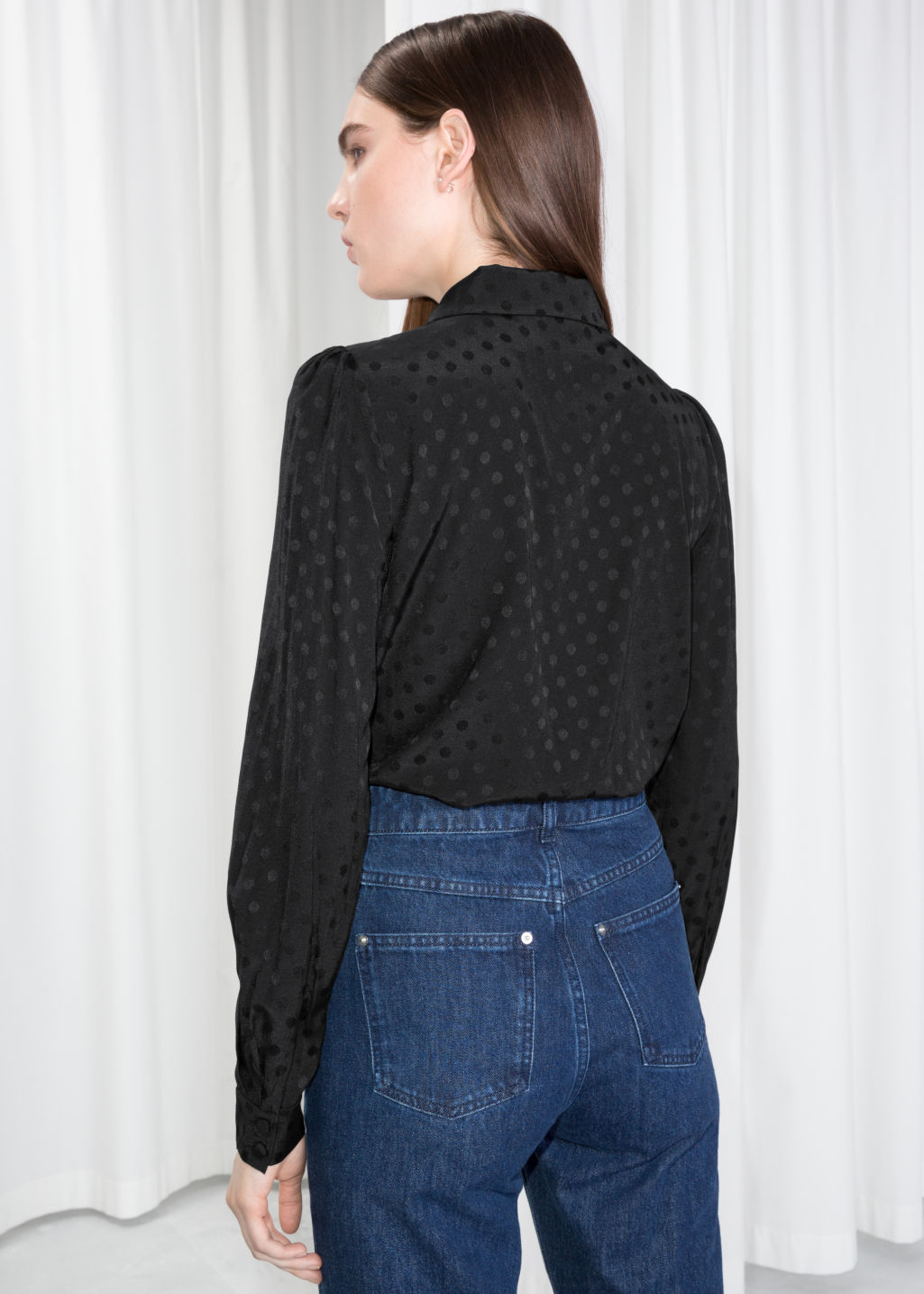 Model back image of Stories ascot ruffle blouse in black