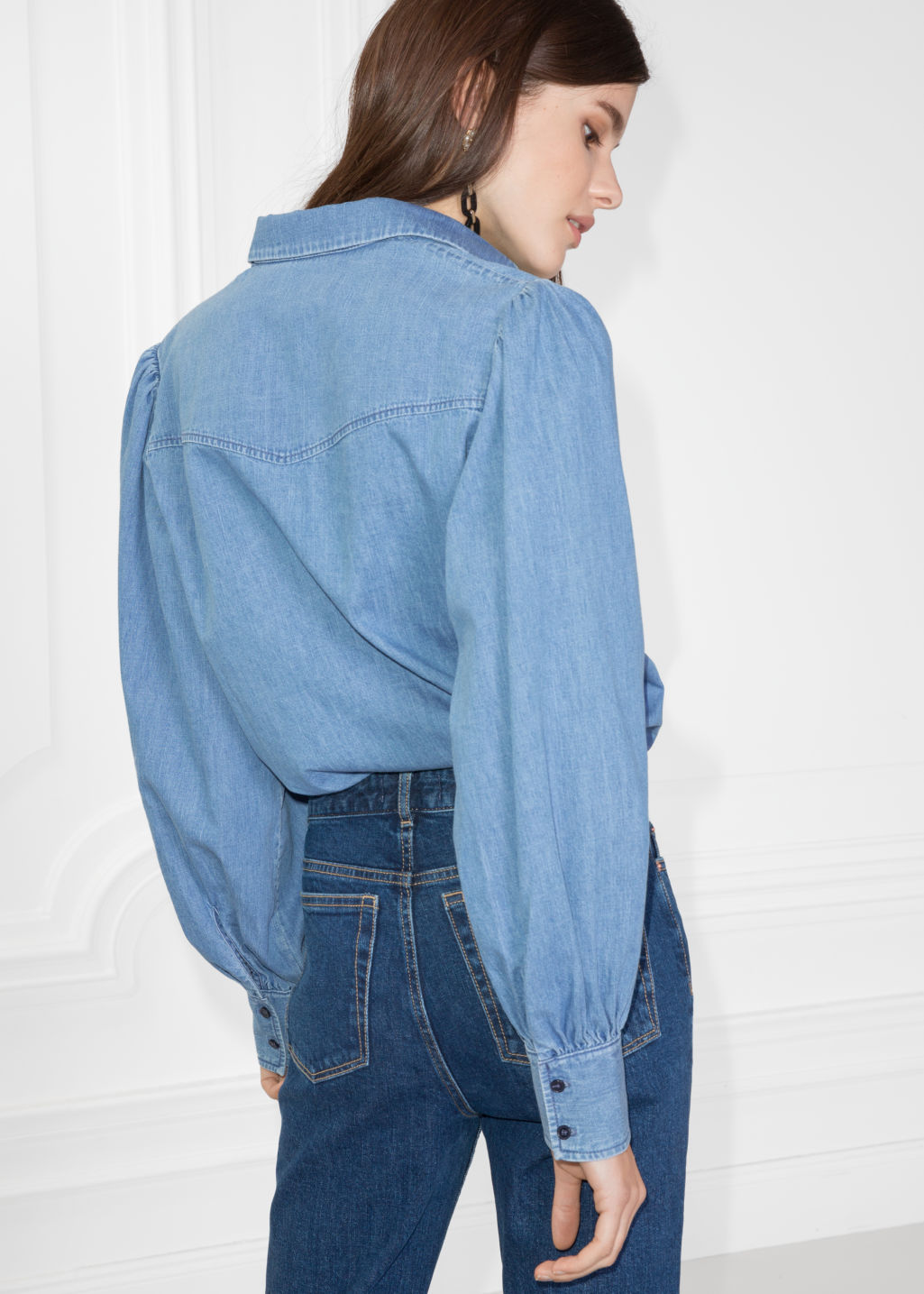 Model back image of Stories denim shirt in blue