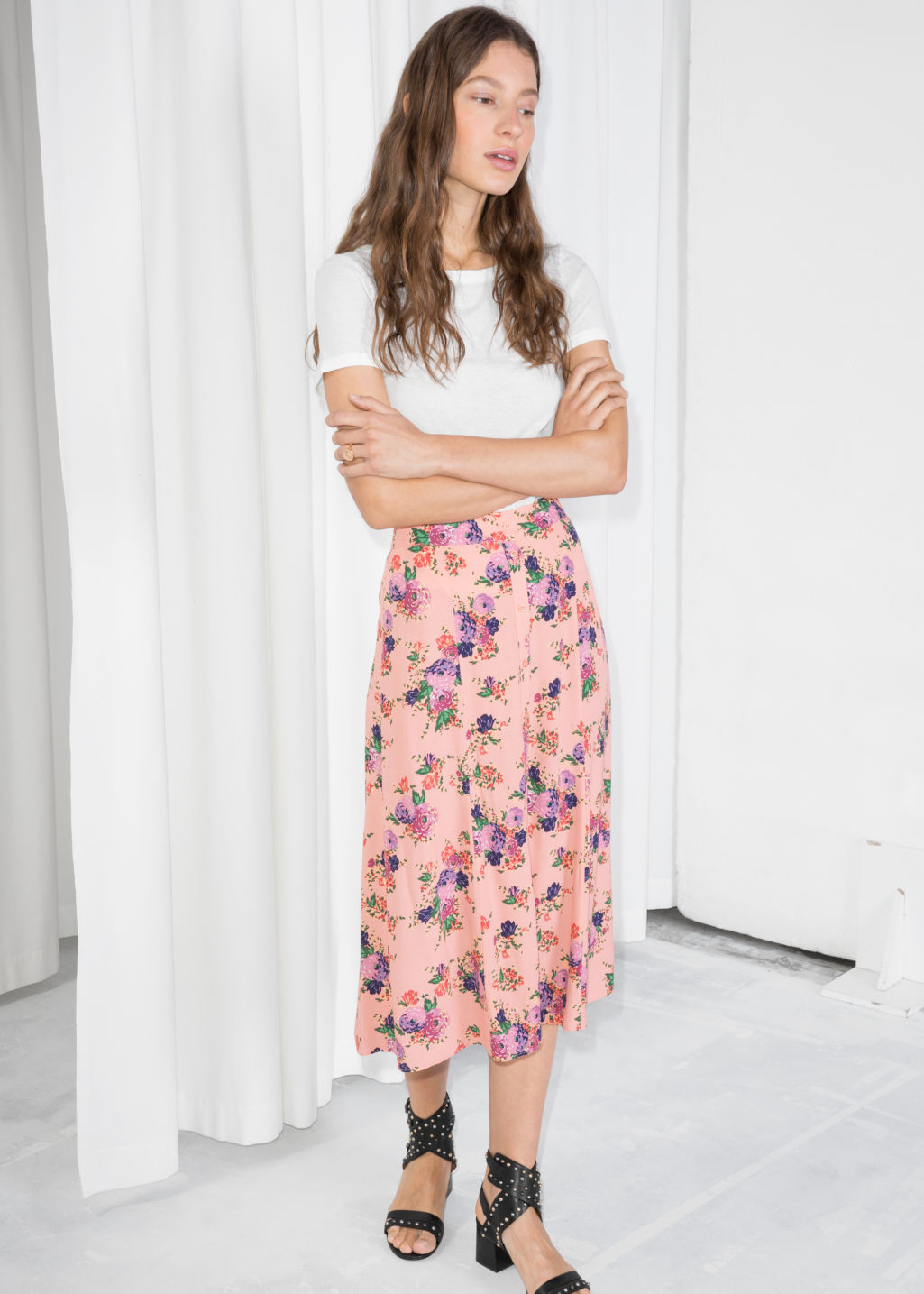 Model front image of Stories poppy print midi skirt in orange