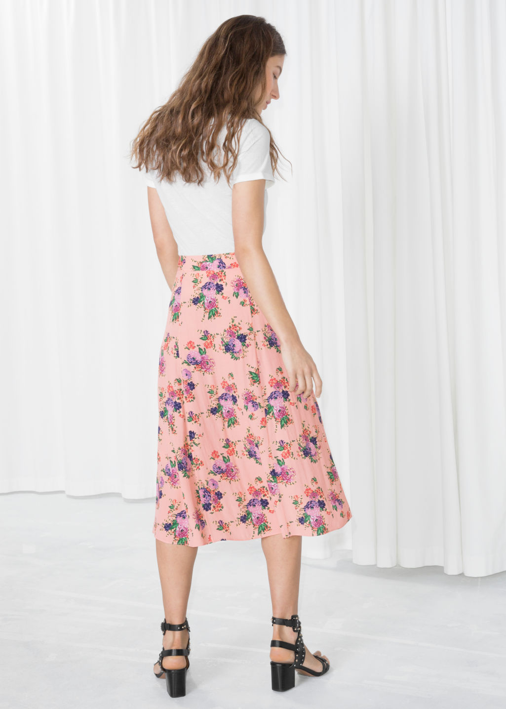 Model back image of Stories poppy print midi skirt in orange