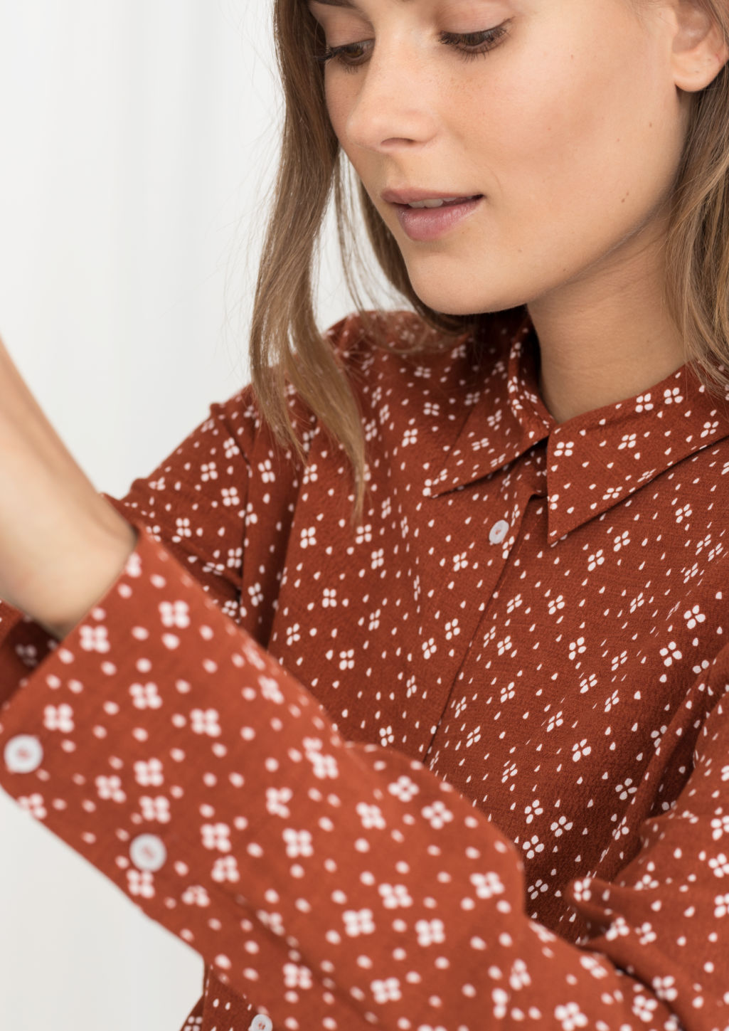 Model back image of Stories button up blouse in orange