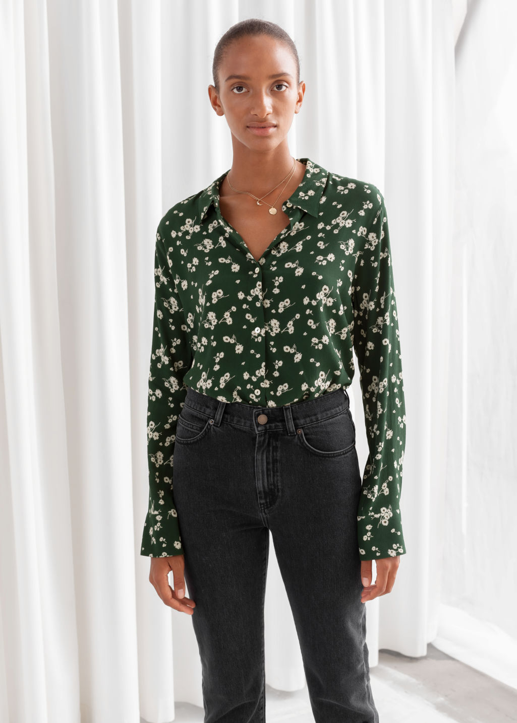 Model front image of Stories button up blouse in green